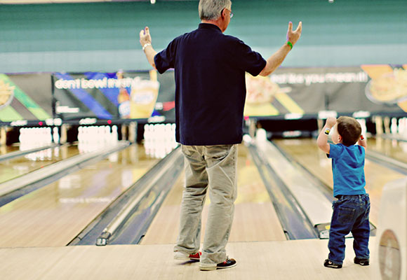 Grandfather and Grandson Bowling